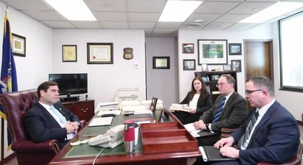 Suffolk County District Attorney Timothy Sini meets with Howard S. Master, who heads the Conviction Integrity Bureau, and his colleagues to discuss the Keith Bush case.