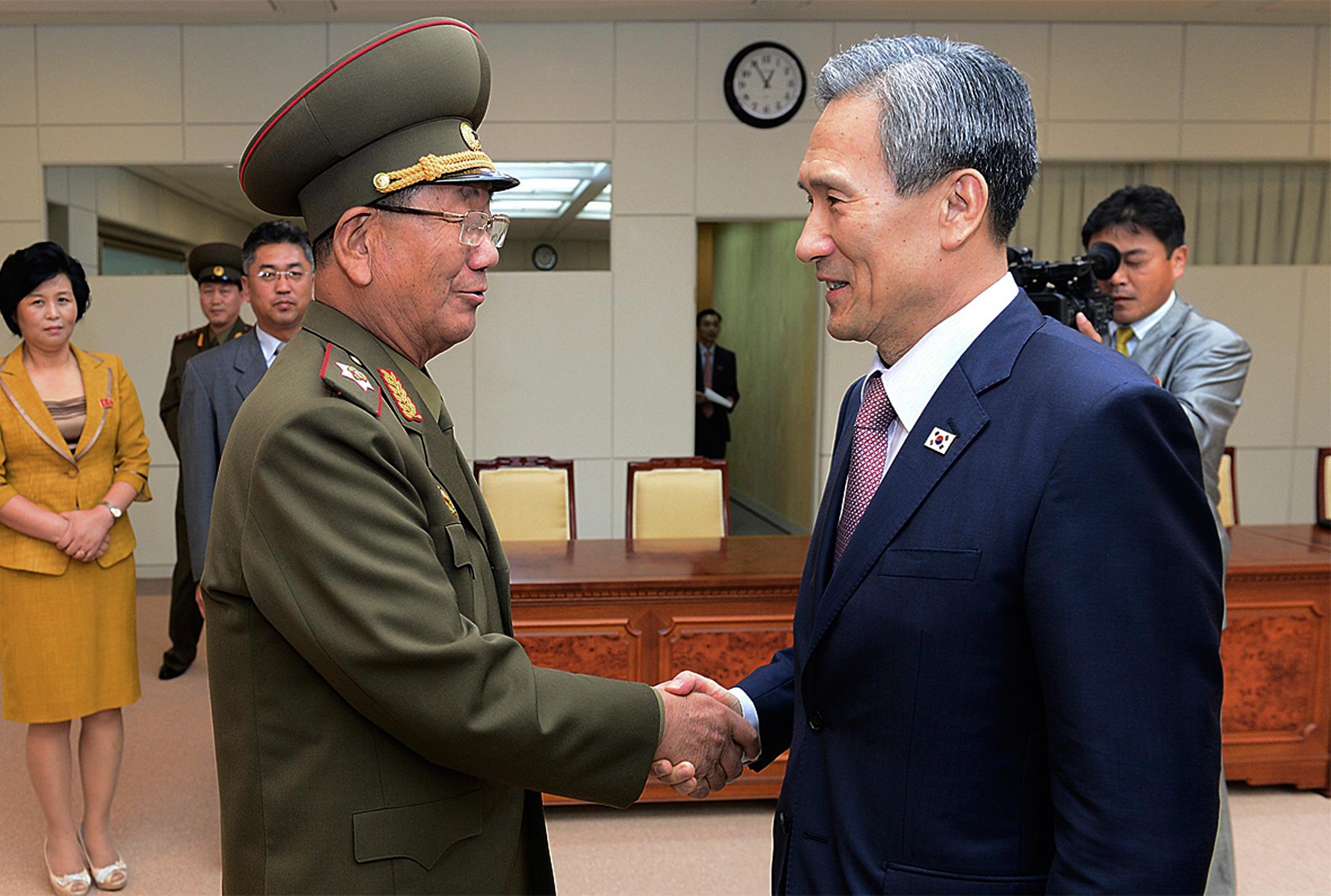 Korean leaders shake hands in Panmunjom in the Demilitarized Zone