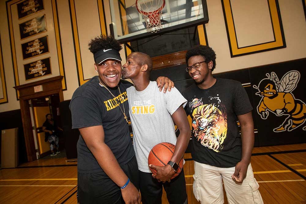 Elijah Jackson, 20, coach Carl Johnson, Jamari Gant, 20 all from Bridgehampton stand inside the gym at the Bridgehampton School in Bridgehampton on Friday, July 20, 2018.