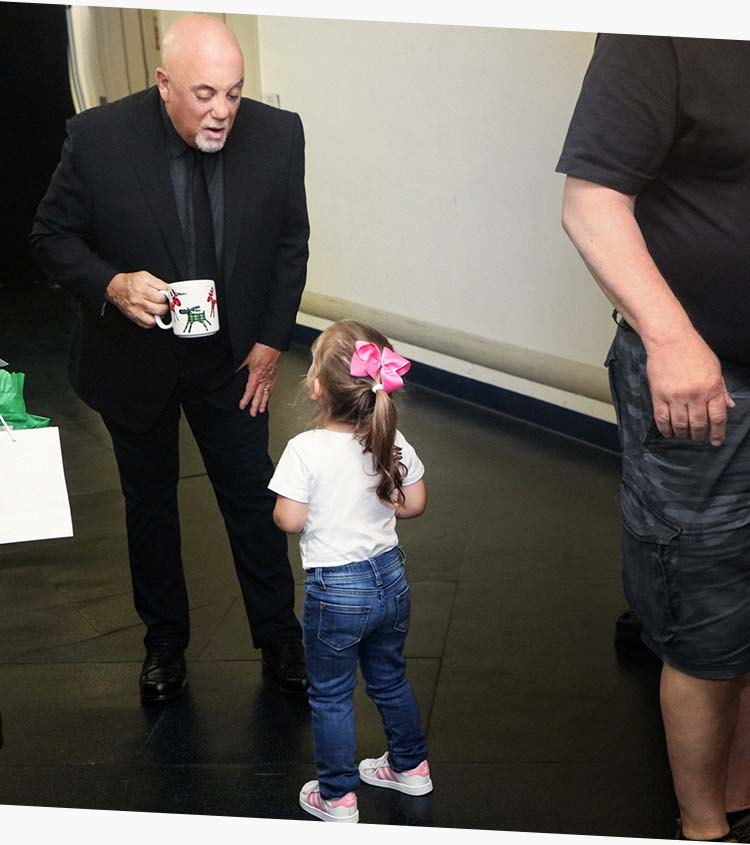 Billy joel at madison square garden oh oh oh for the 100th joel talks to his daughter della backstage at a recent show photo credit myrna suarez m4hsunfo